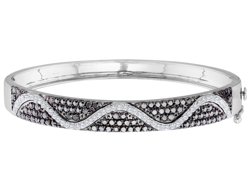 A backdrop of eight-two enthralling black diamonds enhances the light of fifty-four glimmering white diamonds claw set in a curving ribbon. Crafted from 14 karat polished white gold, this stunning 2.50 (ctw) bracelet combines the brilliance of round brilliant cut white and black stones.