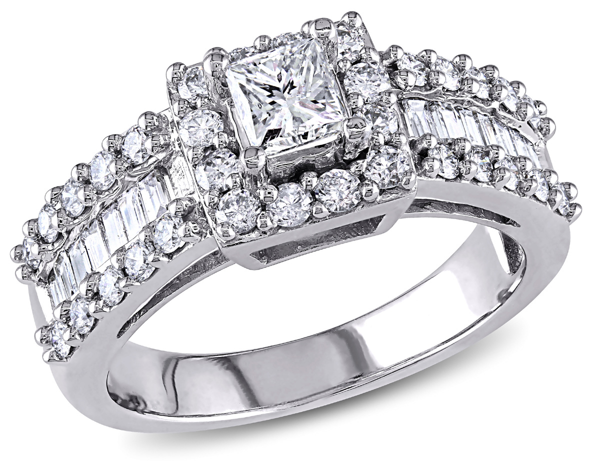 To symbolize your commitment, this  Princess, Round, and Baguette-cut Diamond Engagement Ring is a stunning choice. The white gold ring is prong set with a dazzling princess-cut diamond at center, surrounded by 12 fiery round, prong-set side diamonds. The wide-style band shimmers with a center row of channel-set, baguette-cut diamonds, totalling 14, edged at each side with a total of 20 round, prong-set diamonds. 14 karat white gold completes the look.