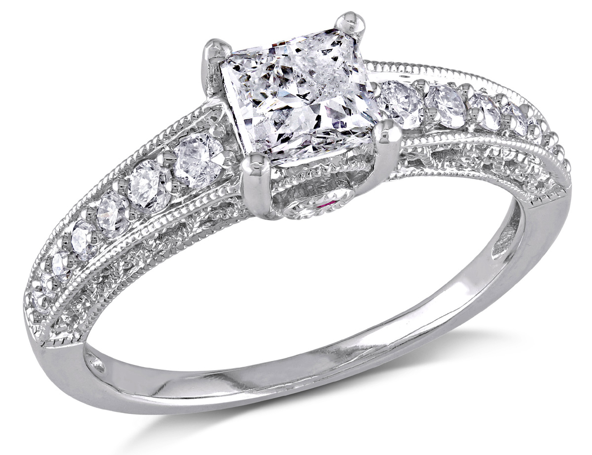 This gorgeous ring features a 3/4 carat princess-cut white diamond center stone band has a infinity motif and a pink sapphire with pave-set diamonds. The ring is crafted of 14-karat white gold and is enhanced a vintage finish.