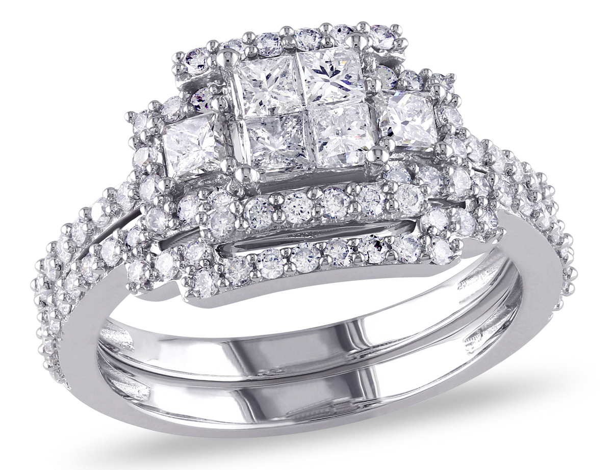 This sophisticated engagement ring features invisibly-set princess-cut white diamonds at its center which give the illusion of a larger center stone within a 3-stone setting. This beautiful ring set is crafted of fine 14-karat white gold and is enhanced with a frame of round diamonds.
